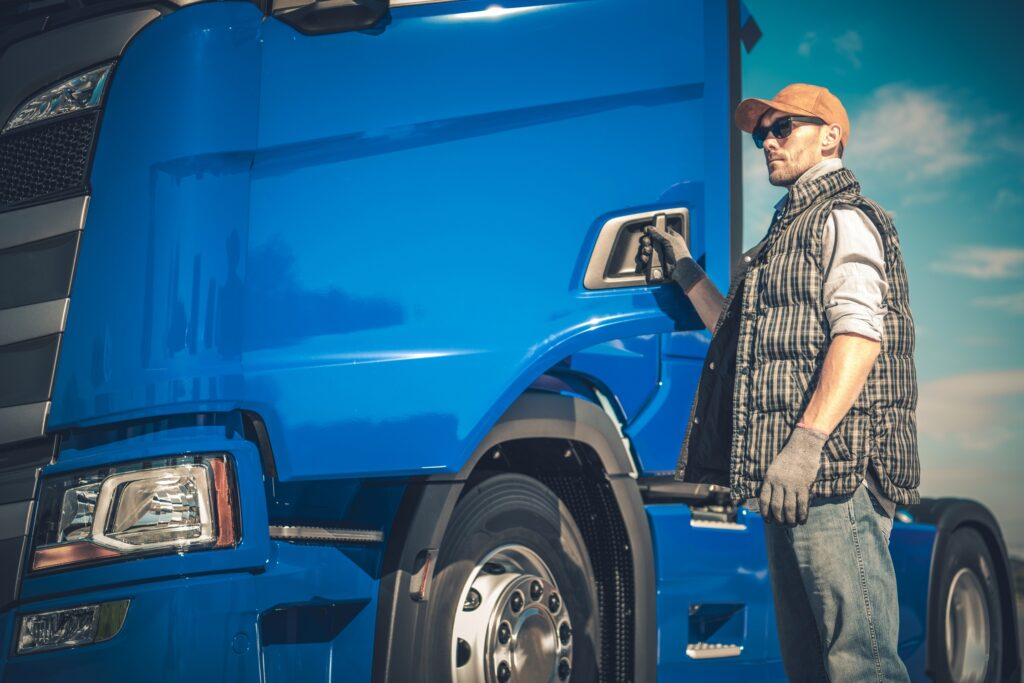 Semi Truck Cargo Transport. Caucasian Driver and the Modern Vehicle. Transportation Industry.